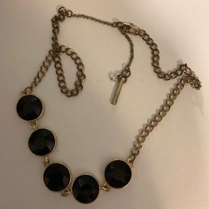 Chunky gold necklace with black stones